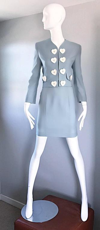 Amazing vintage 90s MOSCHINO Cheap & Chic light blue skirt suit! Wonderful tailored fit, with a high waisted pencil skirt and 1960s style jacket! Oversized white heart plastic buttons adorn the front of the blazer. Hook-and-eye closures up the