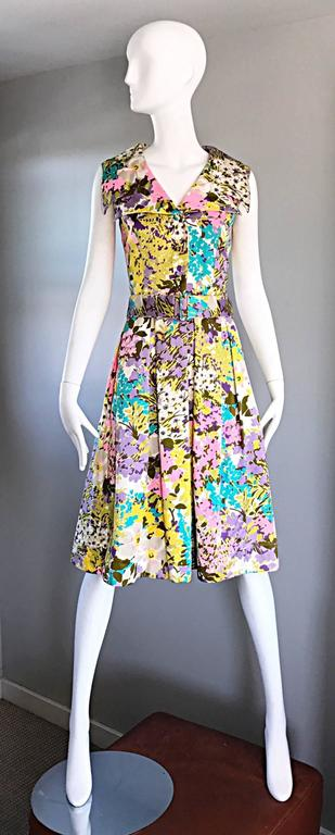 Incredible vintage late 1960s / early 1970s TORI RICHARD for LIBERTY HOUSE A - Line belted shirt dress! Features a beautiful Allover floral print in vibrant pastels. Large oversized Avant Garde collar. Fitted bodice with a flared skirt. Detachable