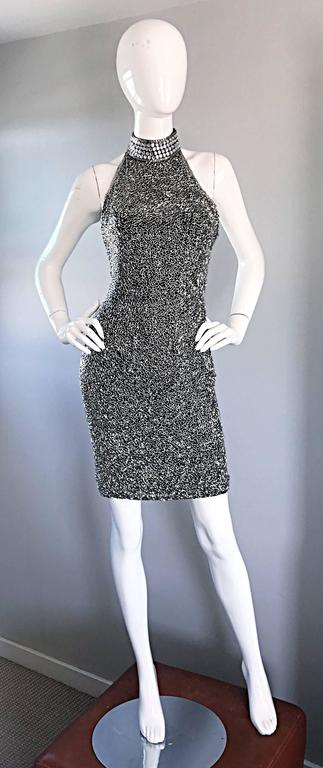 Sexy vintage 1990s LILLIE RUBIN black and silver heavily beaded silk cocktail mini dress! Features thousands of hand-sewn silver beads throughout the entire dress. Oversized silver crystals adorn the back panel and the neck. Super flattering bodcon