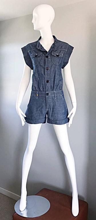Incredible and stylish MISSONI blue jean denim one piece romper! Features navy blue buttons up the bodice. Cuffs at each leg opening. Super soft cotton denim. Belt loops around the lower waist--looks great alone or belted. Pockets at each side of