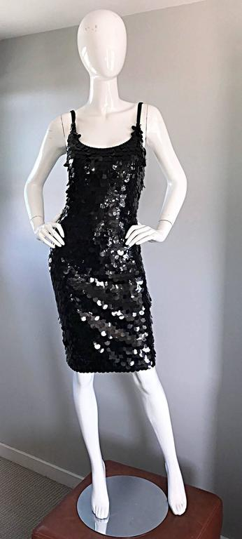 Sexy 1990s SAKS 5th AVE. fully sequined / pailletes and beaded bodcon little black dress! Features thousands of hand-sewn pailletes throughout, with seed beads along the neck and sleeve straps. Hugs the body in all the right places. Super flattering