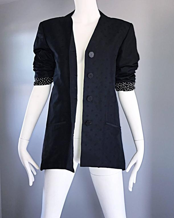 Chic vintage GEOFFREY BEENE classic black jacket! Features a discreet iridescent polka dot print throughout. Four buttons up the front. Pocket at each side of the waist. Lined in chic black and white polka dot printed silk that looks great exposed