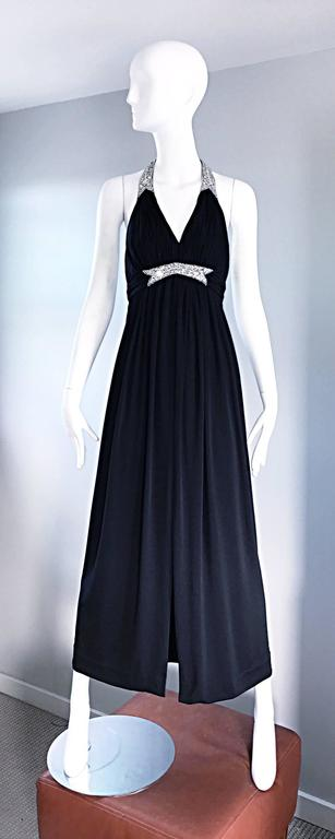Stunning 1970s VICTORIA ROYAL black jersey evening dress! Grecian shilouette, with pleating at the bodice and waist. Hundreds of hand-sewn rhinestones of all different sizes at front waist, and along the neck line and strap. Three hidden