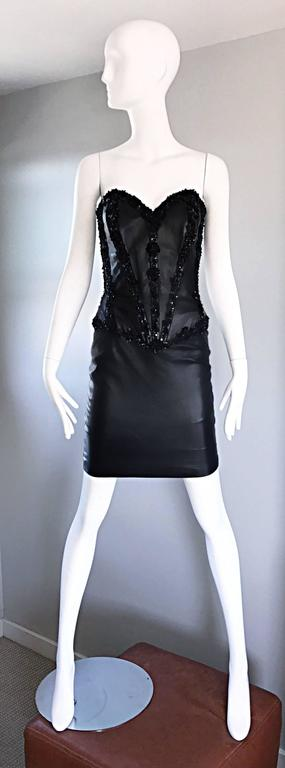 Sexy vintage VICKY TIEL COUTURE for Neiman Marcus 1990s 90s black lambskin leather Bodycon strapless bustier/corset dress! Fitted boned leather bodice, with hand-sewn sequined and beaded panels throughout the front and back. Haute couture