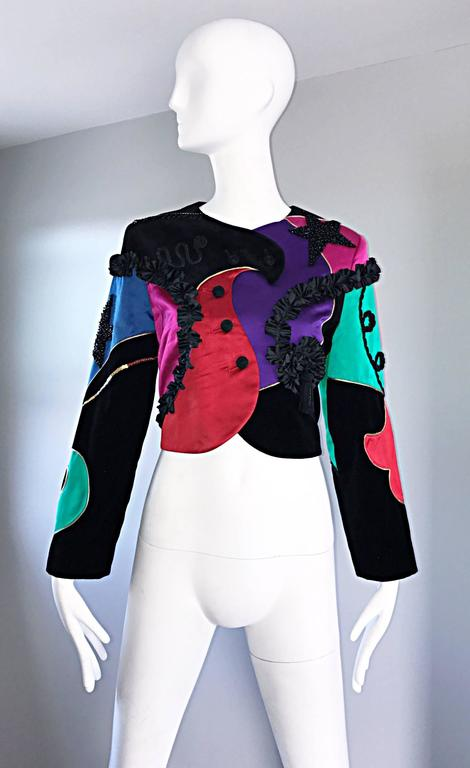 Rare and insanely chic vintage LOUIS FERAUD cropped matador style jacket! Super soft silk and velvet composition, with intricate embroiderery, sequins and beads throughout. Asymmetrically lined buttons up the front. Couture quality, with an amazing