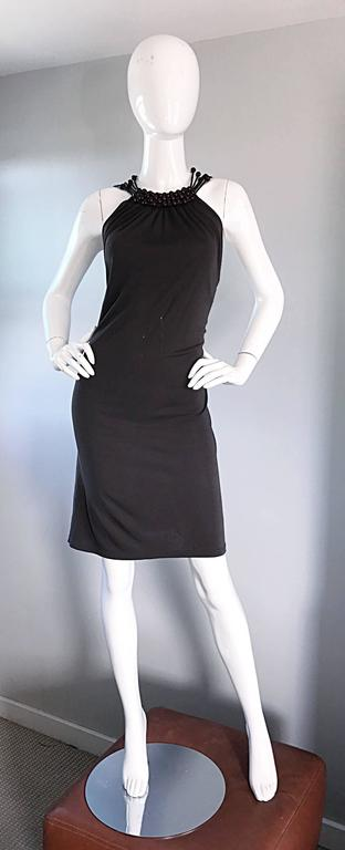 Incredible vintage CELINE, by MICHAEL KORS, moss green rayon jersey dress! Features intricate wooden hand beaded back that reveals just the right amount of skin. Wooden beads also align the front collar. Soft jersey material clings to the body in