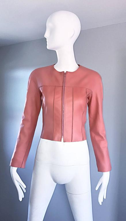 Amazing and rare vintage CHANEL 1990s / 90s bubblegum pink lambskin leather cropped jacket! Super soft leather. Full zipper up the front. Expertly tailored, with a fantastic fitted bodice, and tailored long sleeves. Intricate stitching throughout.