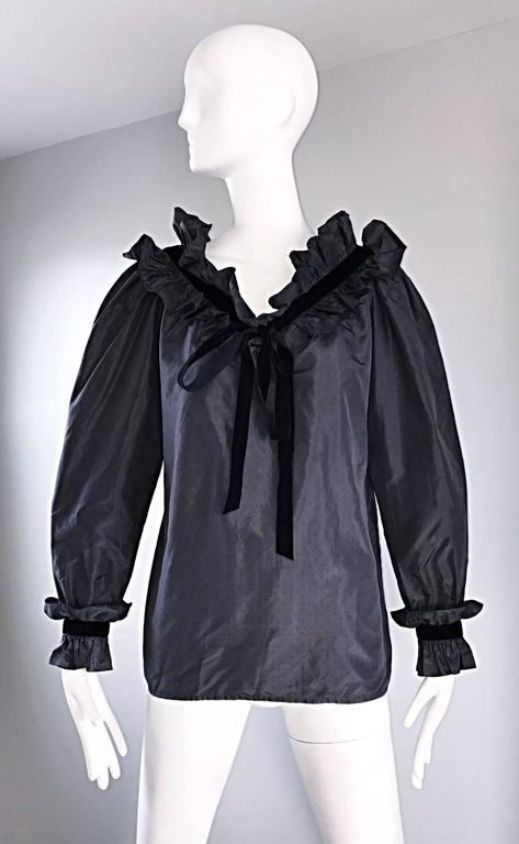 Sensational and rare vintage 1970s YVES SAINT LAURENT 'Rive Gauche' black silk taffeta bow and ruffle blouse from the famed 1976 Russian Collection! Features tiny allover black polka dots throughout. Couture quality, with most of the workmanship