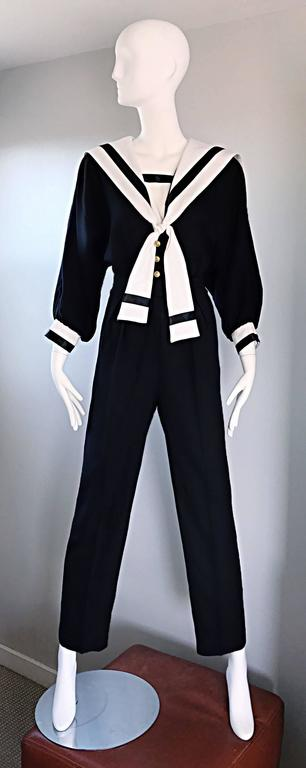 Rare vintage ANDREE GAYE black and white nautical sailor themed onesie / jumpsuit! Super chic, and so on trend! Black body, with a white collar and sleeve cuffs. Lapel features white ties that tie in the front bodice (can be worn loose, or in a