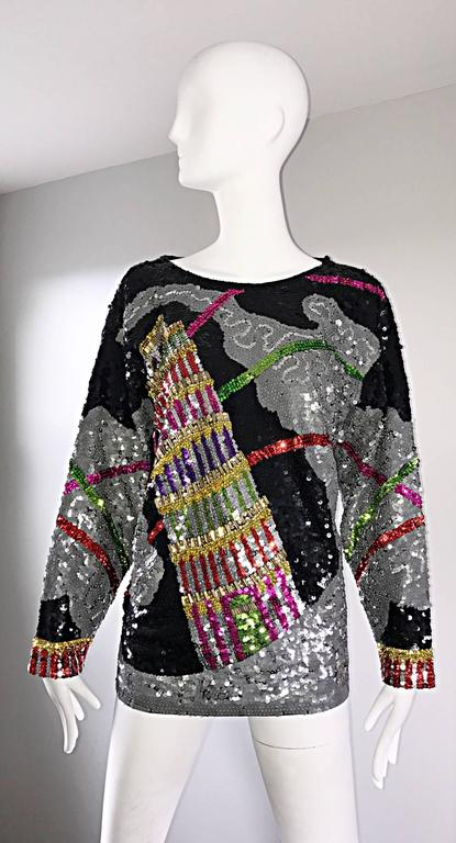 Amazing vintage 'Leaning Tower of Pisa' fully sequined novelty cotton top! Thousands of colorful and black hand-sewn sequins throughout. The perfect statement worthy piece! Single button closure at top back neck. Dolman sleeves and lots of stretch