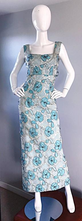Outstanding late 1950s / early 1960s 60s BAIN'S Demi couture turquoise blue metallic beaded sequin gown! Features thousands of hand-sewn iridescent sequins and beads throughout. Shelf bust, with an attached top. Flower pattern throughout. Full metal