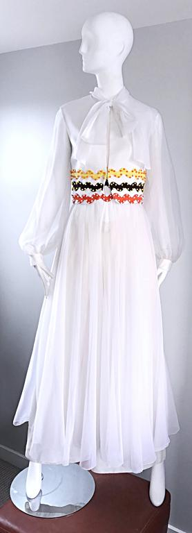 Amazing and super rare vintage OSCAR DE LA RENTA 3 piece chiffon jumpsuit! This has to be one of my favorite vintage pieces EVER! Consists of white wide leg trousers, a white vest with signature ric rac embroiderey (yellow, orange and brown) and
