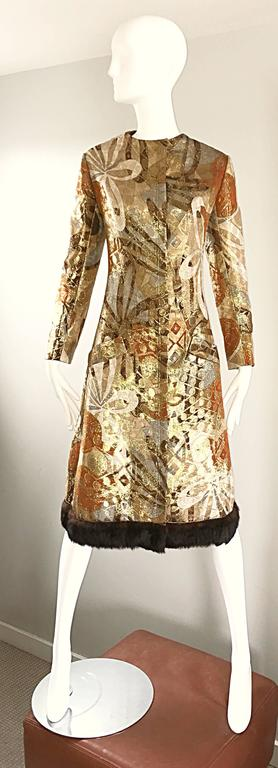 Sensational vintage 1960s BILL BLASS metallic silk A-Line dress or jacket! Features fabulous abstract prints in warm hues of gold, brown, silver, and bronze throughout. Soft brown mink fur trim along the hem. Pockets at both sides of the hips.