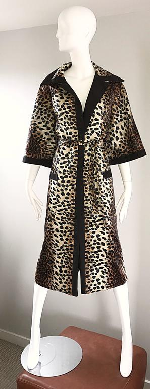 Fabulous vintage 1960s LILLI ANN leopard print belted trench jacket! Features chic 3/4 bell sleeves, and oversized lapels and collar. Patch pocket at each hip. Detachable matching belt. Timeless classic print that will last a lifetime! The perfect