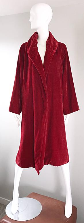 Luxurious 1920s blood red silk velvet flapper jacket! This gem features the softest velvet that I have ever felt! Vibrant red color. Intricately pleated detail at the collar. Interior hidden pocket. Looks great with jeans, or over a dress. Can also