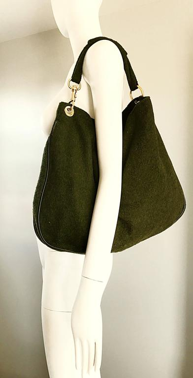 Chic and practical 1960s JOSPEH MAGNIN Italian made dark forest green virgin wool and leather JUMBO hobo handbag! Allover gorgeous dark green soft wool, with leather piping at edges. Strong snap closure. Handle in the same green wool, with removable