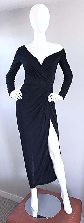 Amazing and sexy late 1970s VICKY TIEL COUTURE black silk jersey evening dress! Unique, yet flattering asymmetrical cut, with one of the sleeves sitting off the shoulder. Flattering ruched boned bodice that stretches to fit. Daring thigh high slit.
