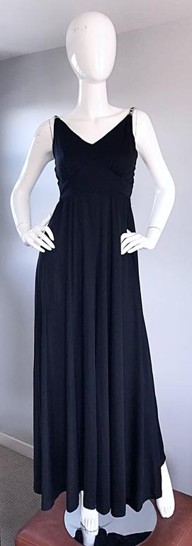 Sensational late 1960s / early 1970s 70s  PATTY PICKENS black jersey + rhinestone palazzo wide leg jumpsuit! Looks like a chic black gown, until you walk! Rhinestone straps, with black gem stones mixed in. Full metal zipper up the back with