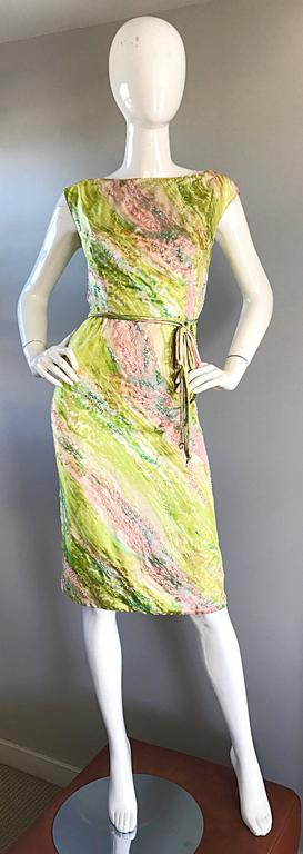 Sensational late 1950s, early 1960s 60s luxurious silk watercolor beaded dress! Features vibrant green, pink, blue and white colors throughout. Thousands of hand-sewn seeds beads throughout. Attached bow self belt at waist. Full metal zipper up the
