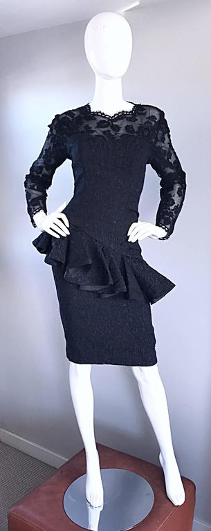 Amazing vintage 1990s LIANCARLO COUTURE black silk chantily French lace peplum Avant Garde cocktail dress! Features a nude illusion bodice, with a fitted torso, and flared peplum. Hidden zipper up the back with hook-and-eye closure. The perfect