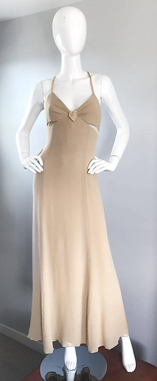 Sensational vintage 90s GIORGIO ARMANI COLLEZINI nude silk chiffon cut-out bias gown! Features side cut-outs at the bust with nude mesh overlays. Boned bodice holds everything in place. Silk straps criss cross on the back, with an additional lower