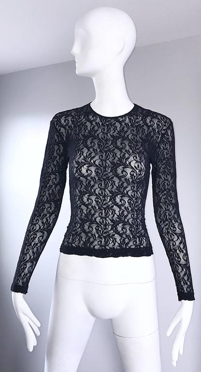 Sexy vintage 90s CALVIN KLEIN black lace cropped top! Features a fine soft lace that stretches to fit. Tailored body, with sleek long sleeves. Looks amazing on! Perfect with shorts, jeans, trousers, or a skirt. In great condition.