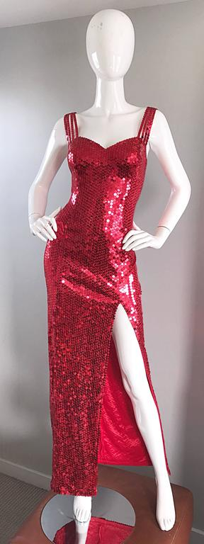 Sexy vintage 90s DELLA ROUFOGALI cherry lipstick red sequin evening gown! Channel your inner Jessica Rabbit in this bombshell number! Features thousands of hand-sewn red sequins. Four straps on each strap. Thigh high slit reveals just the right
