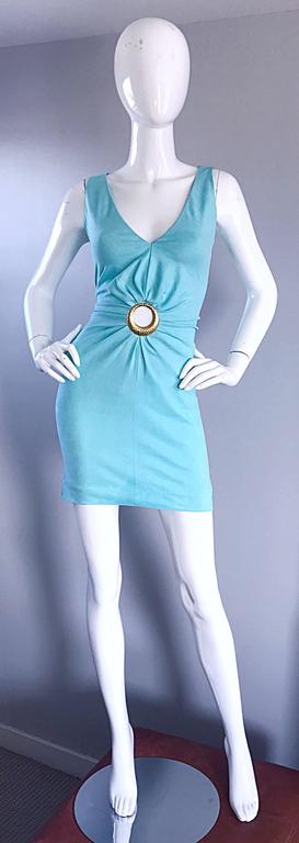 Rare 90s IKITO robins egg blue / light turquoise sexy mini dress! Soft rayon blend hugs the body in all the right place, and stretches to fit. Hammered gold cut-out rin above the bust. Stretches to fit an array of sizes. Hidden zipper up the back