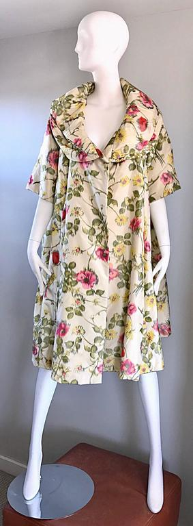 Beautiful late 50s LILLIE RUBIN silk opera jacket! Features roses and flowers in pink, yellow and green throughout, with ivory background. 3/4 sleeves, with a multiple layered collar. Fully lined. A classic gem that looks amazing on, and can fit an