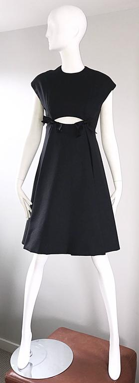 Rare MUSUEM QUALITY vintage 60s GEOFFREY BEENE black silk cut-out short sleeve A-Line dress! This one's for the musuems! Classic black dress, with a mod twist. Cut-out below the bust, with two black satin bows. Heavy duty silk holds shape nicely.