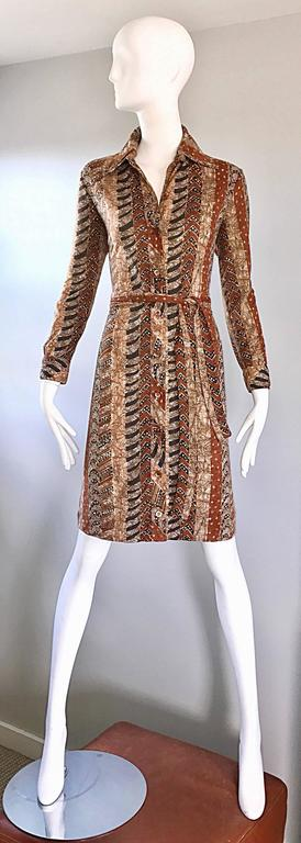 Chic vintage  1970s BONWIT TELLER batik printed cotton shirt dress! Features warm tones of brown, terra-cotta, tan and ivory. Buttons up the entire front, and at each sleeve cuff. Detachable matching tie belt gives a nice shape. Super soft cotton.