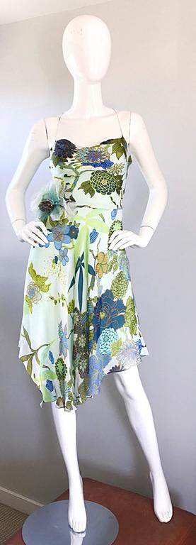 Pretty and flirty 90s JENNY PACKHAM silk chiffon vintage handkerchief hem dress! Features warm vibrant colors of blue, green, chartreuse, teal, and Burt orange throughout. Features a corsage flower at right side waist. Halter neck, with a