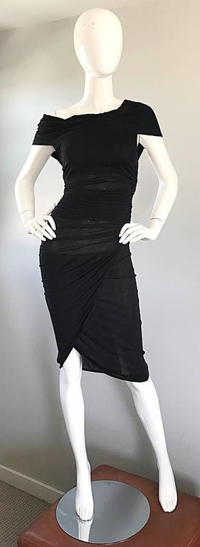 Sexy CELINE 90s black vintage bodcon dress! This is the perfect little black dress! Features flattering ruching detail thorughout. Semi sheer in all the right places, that do not require additional undergarments. Sits off one of the shoulders.