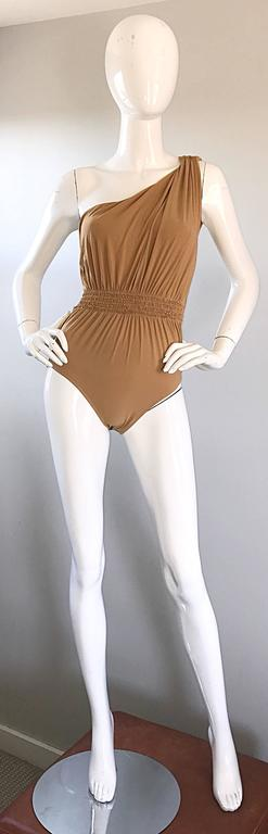 Exceptional LANVIN by ALBER ELBAZ Grecian inspired one shoulder bodysuit or one piece swimsuit! Wonderful draping throughout the bodice, w/ a ruched waistband. Simply step into this flattering little number. Looks amazing on! Can be paired with
