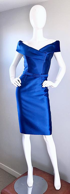 Sensational CATHERINE REGEHR $3,250 vibrant royal blue off-the-shoulder belted dress! Flattering body hugging fit looks amazing on! Features a matching detachable belt. Couture workmanship with so much attention to detail. Hidden zipper up the back