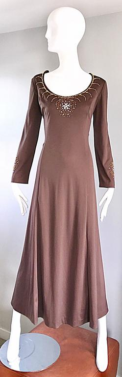 Gorgeous vintage 1970s light brown / coffee jersey long sleeve maxi dress! Gold beads and crystal rhinestones adorn the bust and bottom of each sleeve. Hidden metal zipper up the back with hook-and-eye closure. Looks amazing on, and can be worn