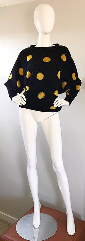 Fabulous and rare early 80s GIANNI VERSACE black and yellow polka dot intarsia sweater! From one of Versace's first collections in 1981. This fantastic piece of fashion history features a black background with yellow polka dots. Super soft chenille