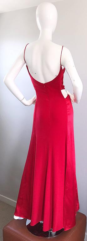 Beautiful sexy vintage 90s ANGEL SANCHEZ red silk and satin cut-out bias cut evening dress! Features a red silk body, with red satin bodice and side panels. Cut-outs at each side of the waist, and on the lower bodice. Hidden zipper up th eback with