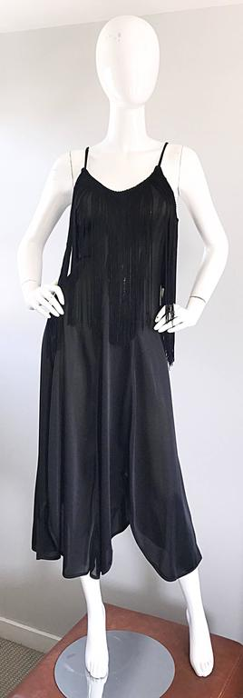 Incredible 70s black disco fringe dress! Features a flirty handkerchief hem, with a tailored bodice. Tons of fringe at the bust makes for a great dancing dress! There is definitely an ode to the 1920s / 20s with this amazing gem! Very well made,