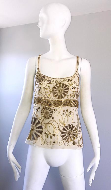 Beautiful vintage EMANUEL UNGARO plus size beige / ivory silk chiffon beaded sleeveless blouse! Features hundreds of hand-sewn sequins, beads and sequins throughout. Hidden zipper up the side. Can easily be dressed up or down. Great with shorts,
