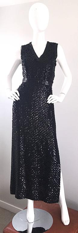 Gorgeous vintage 70s LILLIE RUBIN black silk fully sequined sleeveless gown! Features thousands of hand-sewn sequins throughout the entire dress. Attached belt hooks closed at the back center waist. Slit up the side left leg reveals just the right