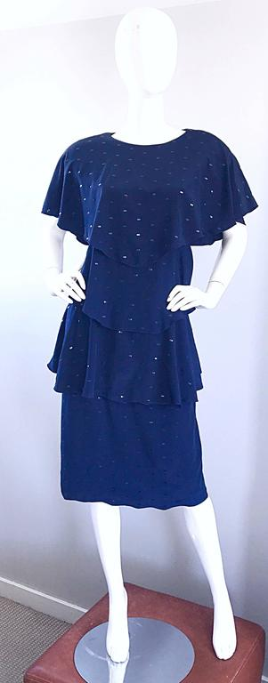 Beautiful vintage HOLLY'S HARP for BERGDORF GOODMAN navy blue flapper inspired dress! Features signature layers of luxurious navy blue silk and black sequins throughout. Button closure at top back neck. Exaggerated shoulders look extra chic and add