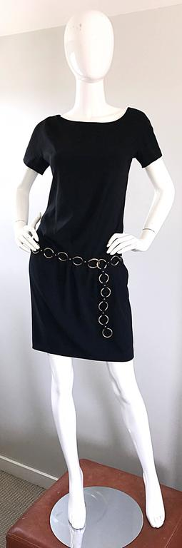 Fantastic vintage 90s MOSCHINO CHEAP & CHIC black dress, with attached silver loop link belt! Intricate detail, with flattering drapes and gathers throughout. Attached belt can be adjusted to fit. Hidden zipper up the side with hidden snap