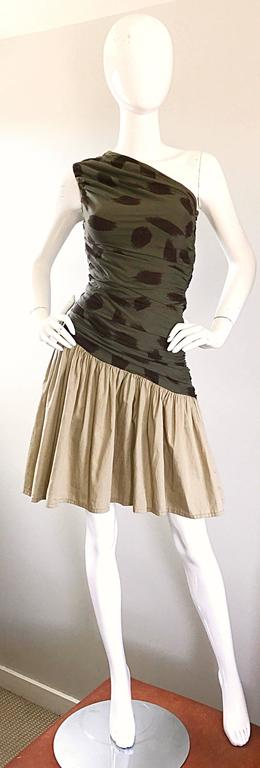 Amazing vintage early 1990s abstract leopard cheetah print one shoulder sexy cotton toga dress! Features a hunter green bodice with brown leopard abstract print. Asymmetrical hem, with a khaki beige pleated skirt. Flattering ruching throughout. Very
