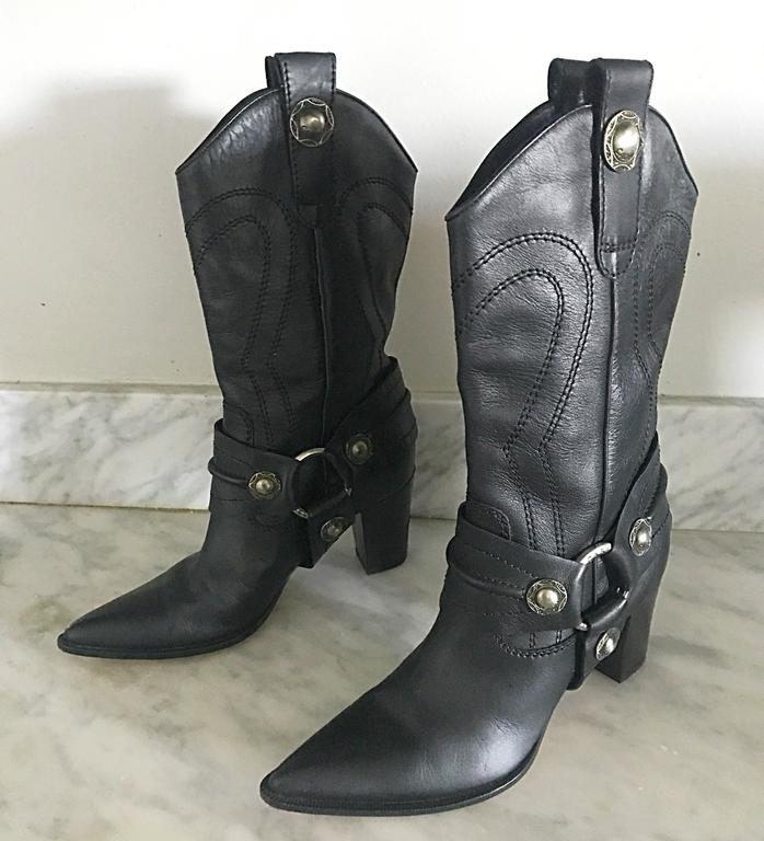 New and sold out CASADEI black leather western inspired high heeled cowboy boots! Features intricate silver hardware, and black embroidery throughout. Hits mid-calf, and can easily be worn with jeans, shorts, a skirt, or a dress. Super comfortable,