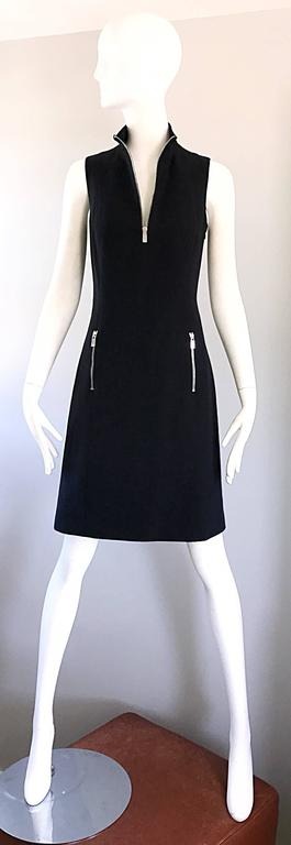 Brand new with tags MICHAEL KORS COLLECTION Runway black sheath dress! Functional silver zipper up the bodice, and at each side pocket. Stretch cotton flatters the body. Neck can be worn zipped up or left open. The perfect little black dress ( LBD )