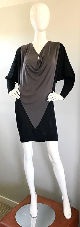 Chic vintage C.D Greene late 90s black and grey color block rayon jersey dress! Chic slouchy flattering fit can accomodate an array of sizes. Features a peek-a-boo back with ties that have rhinestone balls at the end of each string. Matching