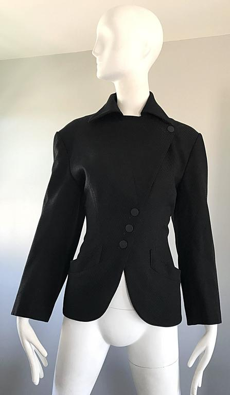 Amazing and rare musuem held AZZEDINE ALAIA mid 1980s black corset style Avant Garde jacket! Versions of this rare gem were featured in the Alaia exhibit at The Groningen Musuem, and the book,