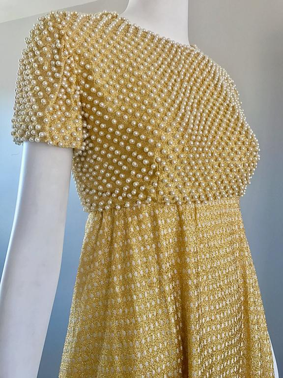 Stunning and rare 1960s GEOFFREY BEENE Couture Gold metallic pearl encrusted silk lurex gown! Features hundreds of hand-sewn white pearls throughout the front and back of the bodice. Fitted bodice with a full skirt. Skirt features white polka dots