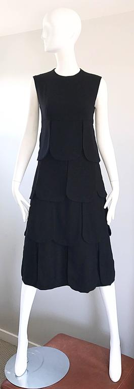 Rare and Iconic 1960s PIERRE CARDIN Haute Couture black Space Age midi dress! Features panels of lined black wool that look amazing with movement! Fitted bodice with a flattering A-Line skirt. Full metal zipper up the back with hook-and-eye closure.